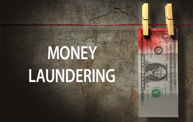 Text Money laundering, banknote hanging on washing robe